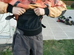 Vrstvení komínu mezi bundou a kalhotama